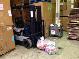 Forklift with 2 childrens toy bags to ship